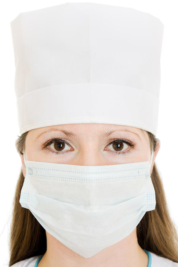 De arts die van de vrouw een masker en een hoed draagt royalty-vrije stock fotografie