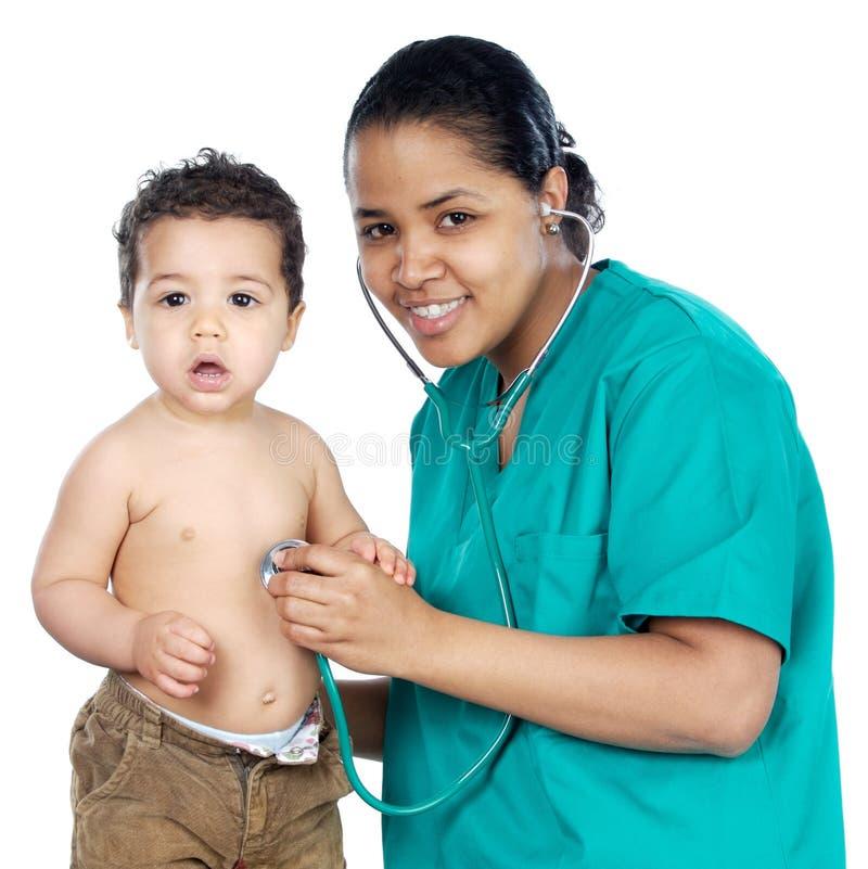 De arts van de dame met een baby royalty-vrije stock foto