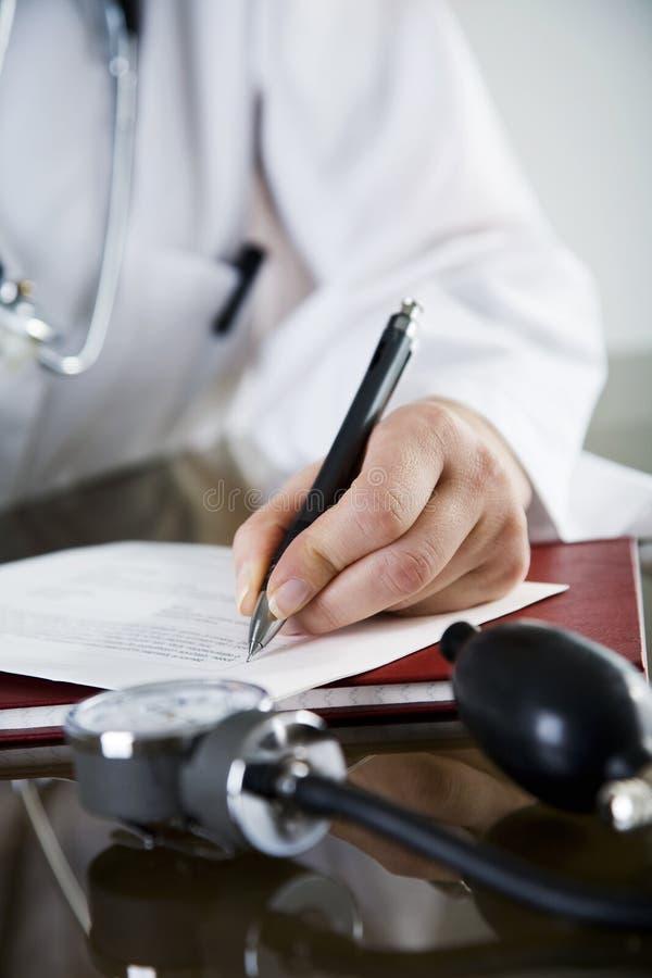 De artsen nemen van nota stock fotografie