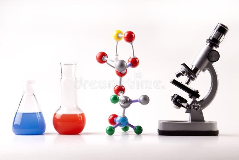 De Atomen van de microscoop en de Vloeistof van de heks van Flesjes en stock foto's