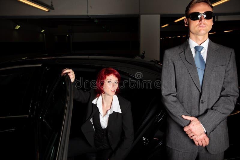 De Auto van maffiachick getting out of the stock foto's