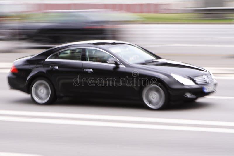De autosnelheid van de luxe stock afbeeldingen