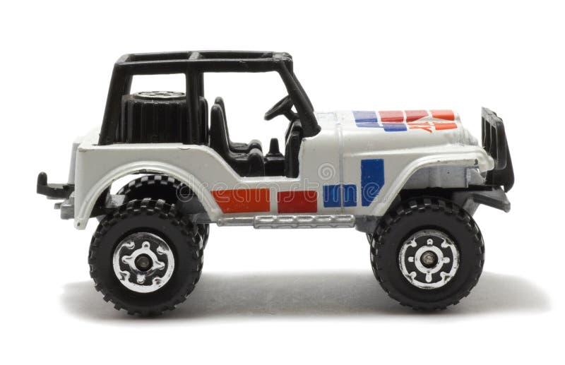 De autostuk speelgoed van de jeep stock afbeelding