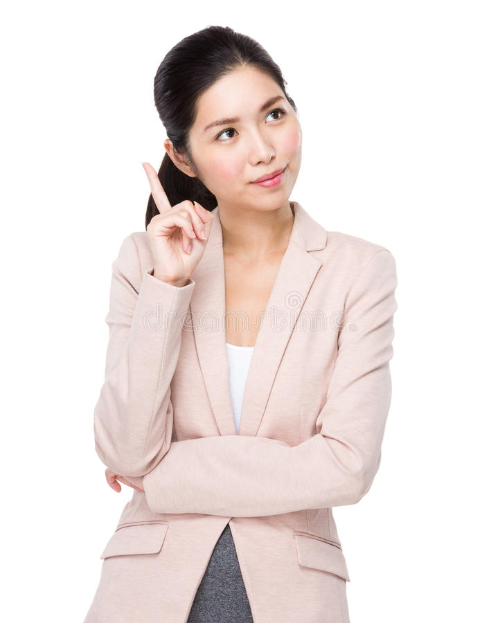 De Aziatische bedrijfsvrouw denkt aan idee stock fotografie
