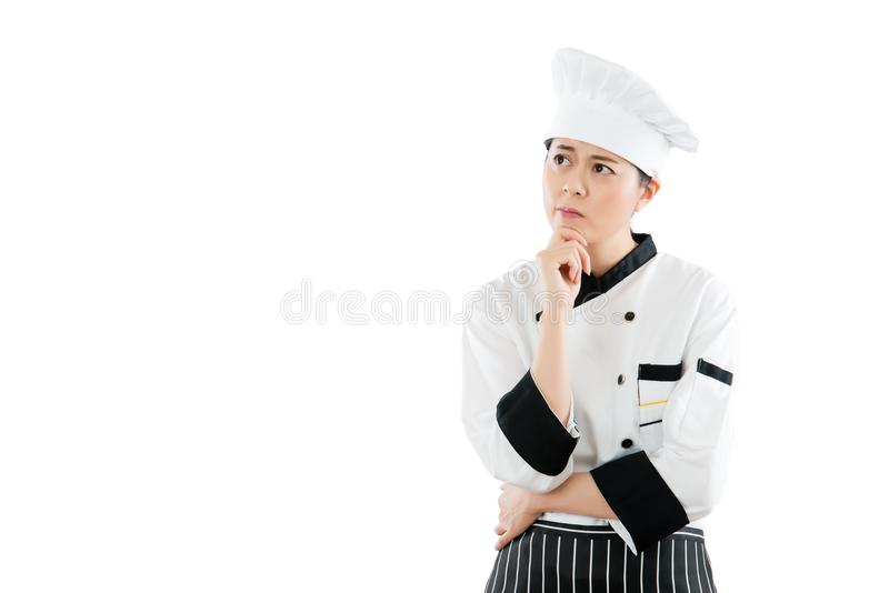 De Aziatische mooie vrouwelijke chef-kok denkt stock fotografie