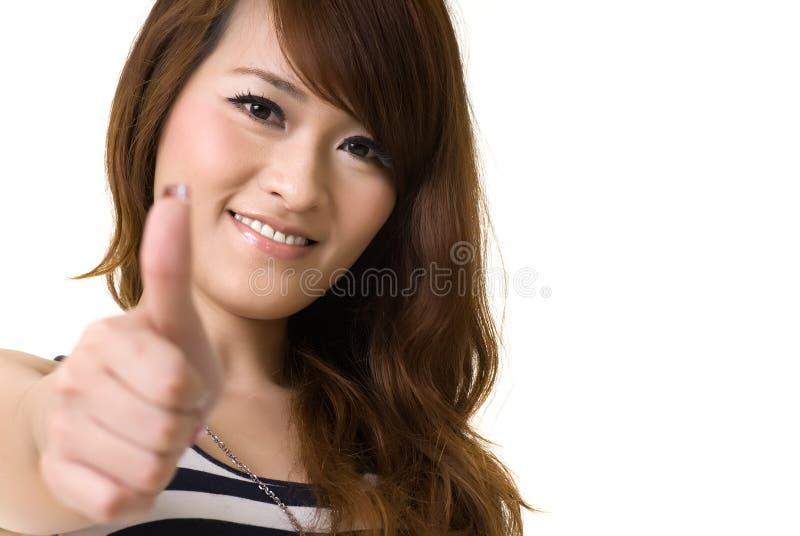 De Aziatische vrouw geeft u uitstekend teken royalty-vrije stock foto's
