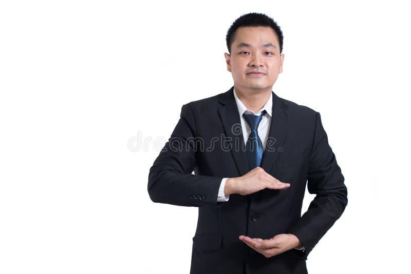 De Aziatische zakenman overhandigt open Uw voorwerpen zijn hier Zakenman royalty-vrije stock afbeelding
