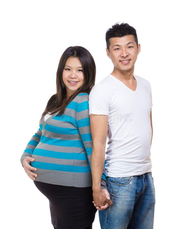 De Aziatische zwangere hand van de paarholding stock afbeeldingen