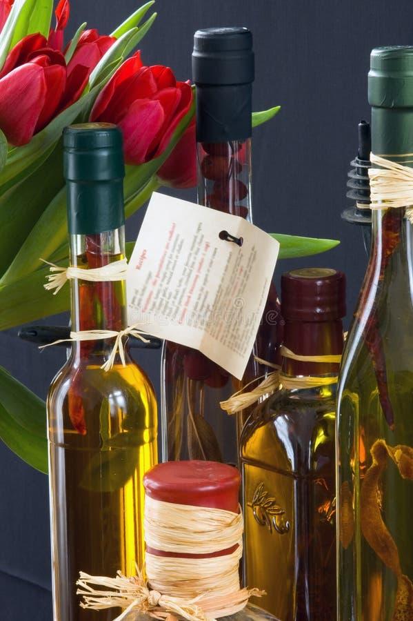 De Azijnen & de Bloemen van Herbed stock afbeelding