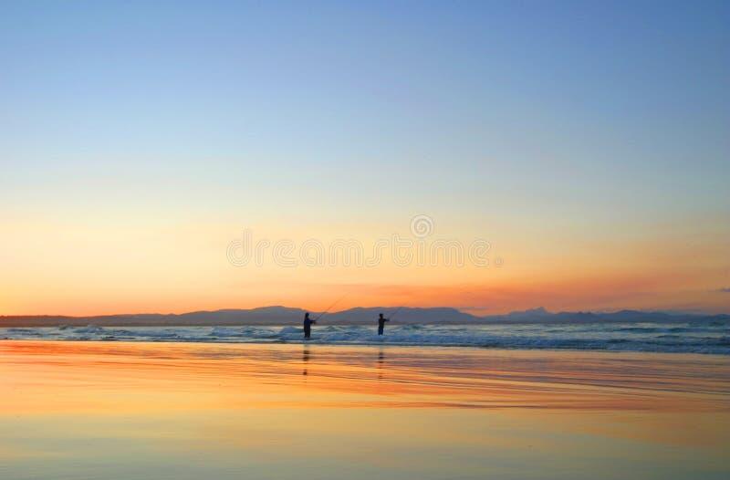 De Baai van Byron van het Strand van Wategos van de visser stock afbeeldingen