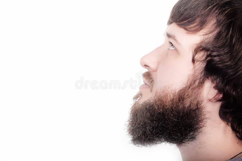 De baard is zijn stijl Close-upprofiel die van de gebaarde mens zich tegen witte achtergrond zonder enige emoties bevinden, enkel stock afbeeldingen