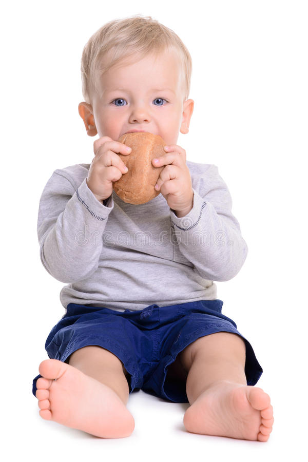 De baby eet brood royalty-vrije stock foto's