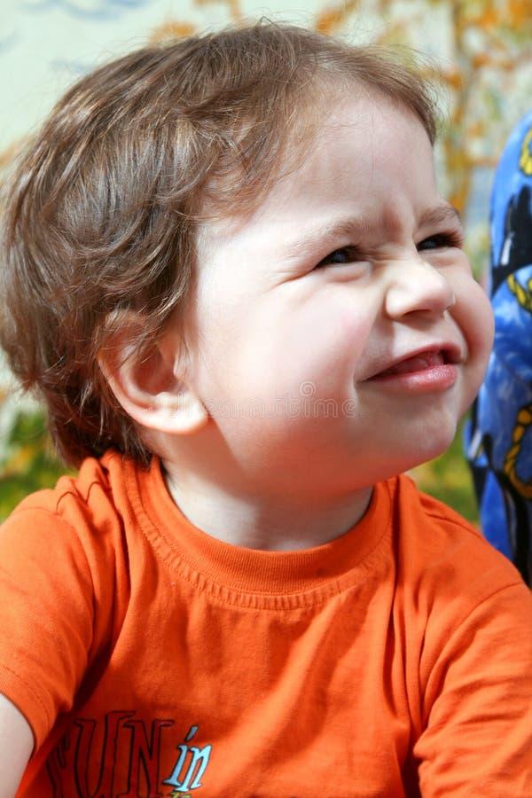 De baby maakt gezicht stock foto's