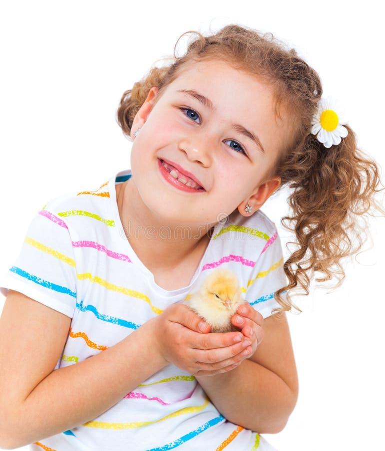 De babykip van de meisjesholding stock foto