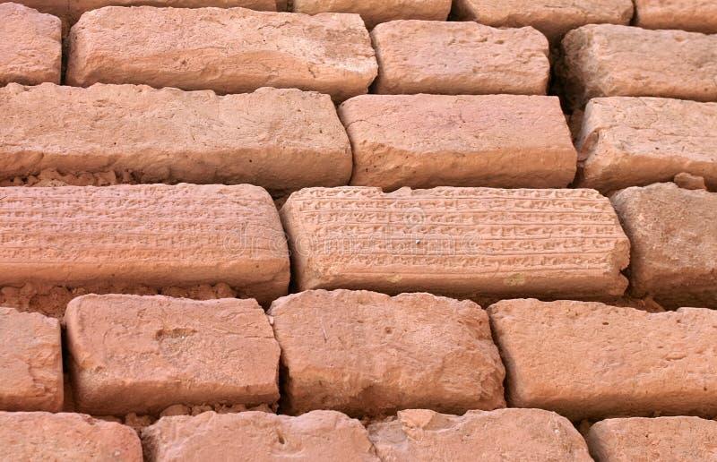 De bakstenen met het wigvormige schrijven, doen zwijgen, Iran stock afbeeldingen