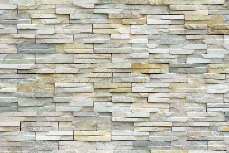 De bakstenen muur van de steen stock afbeelding