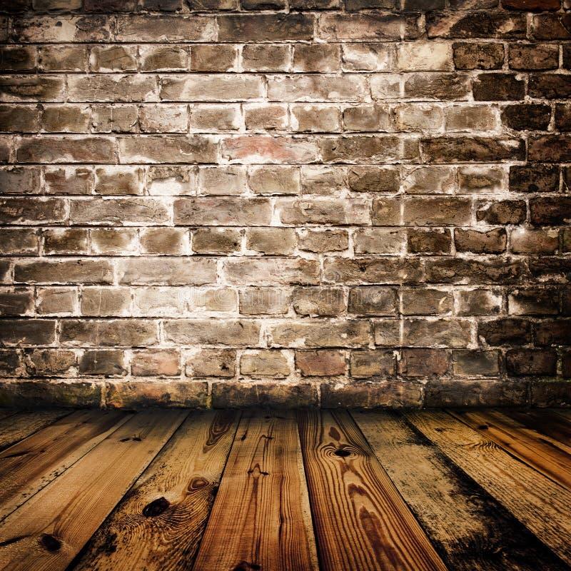 De bakstenen muur van Grunge en houten vloer