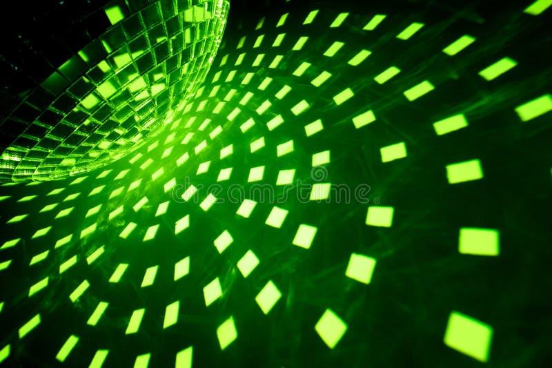 De bal van de disco met groene verlichting royalty-vrije stock foto's