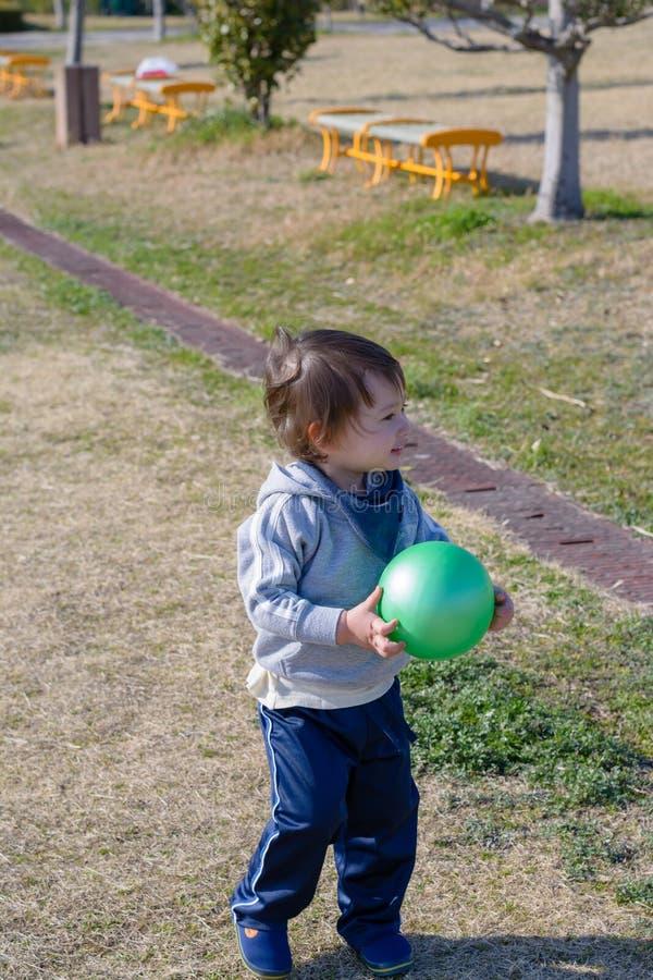 De Bal van de jongensholding in Speelplaats royalty-vrije stock fotografie