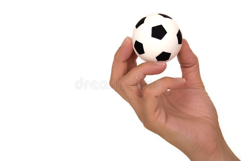 De bal van het de holdingsvoetbal van de hand royalty-vrije stock afbeelding