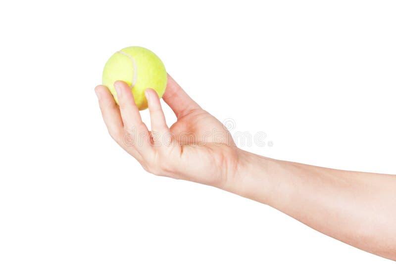 De bal van het tennis in zijn hand. Close-up royalty-vrije stock foto's