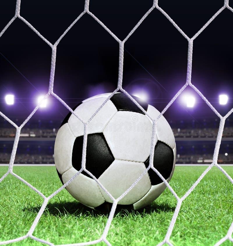 De bal van het voetbal op stadion royalty-vrije stock afbeelding