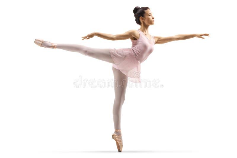 De ballerina in een arabesque stelt royalty-vrije stock foto's