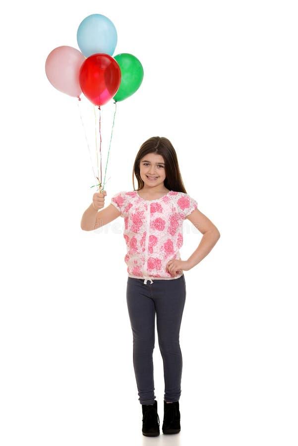 De ballons van de meisjeholding royalty-vrije stock foto's
