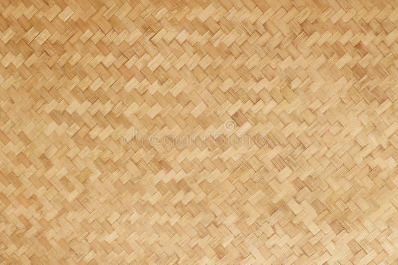 De bamboe geweven vlakke achtergrond van het mat natuurlijke bamboe stock afbeelding