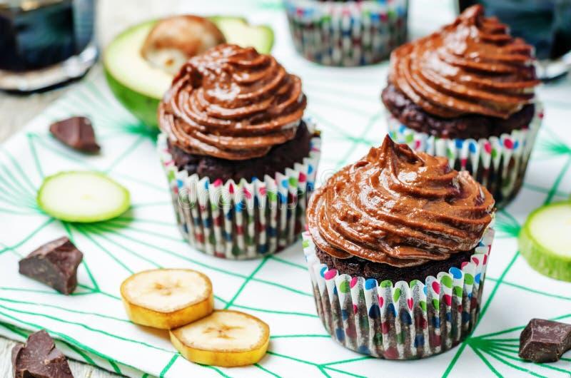 De banaan van de chocoladecourgette cupcakes stock foto's