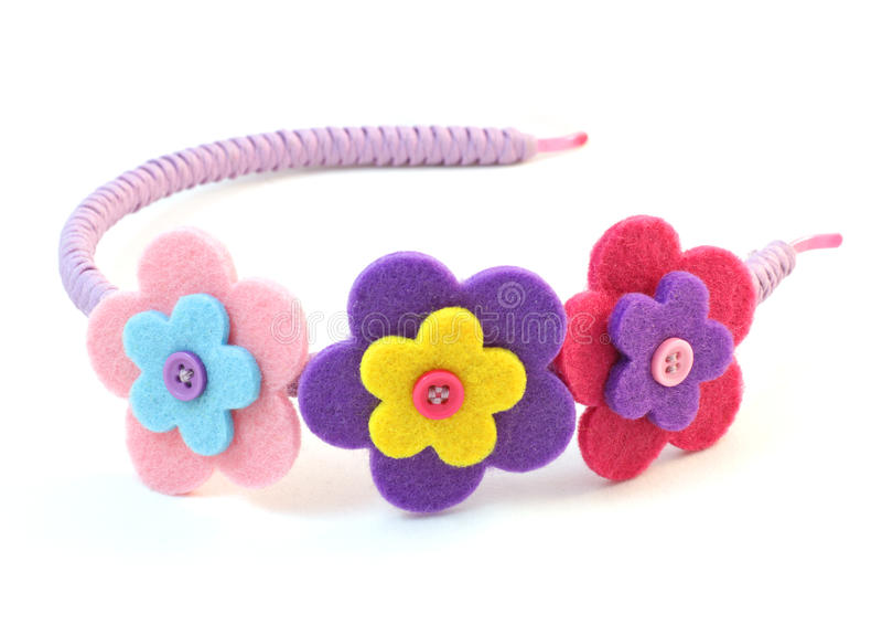 De band van het haar met drie bloemen stock afbeeldingen
