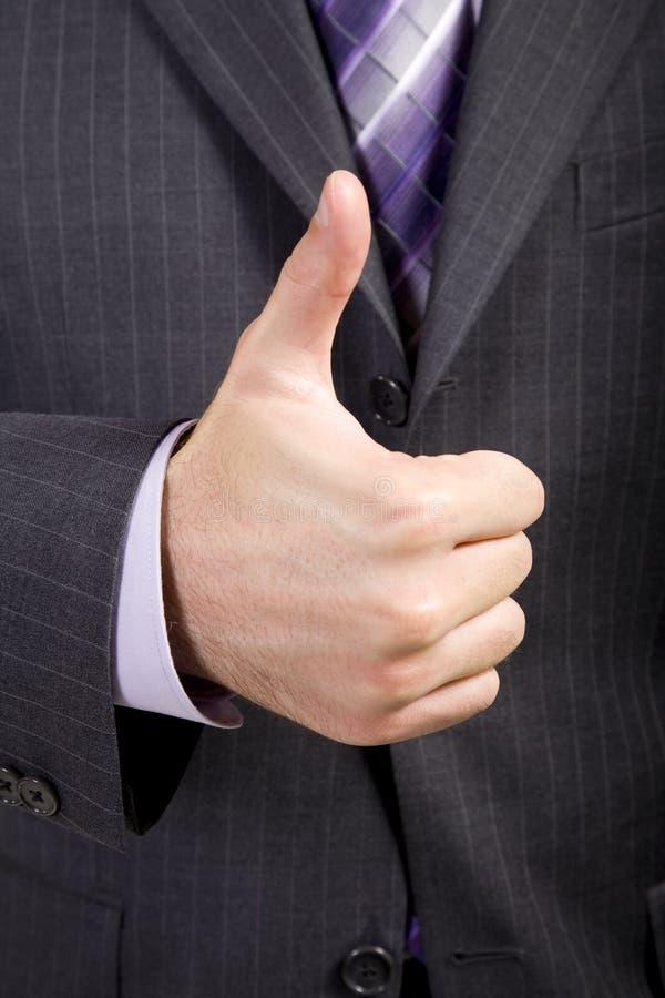De bedrijfs Mens biedt duim-omhoog aan stock foto
