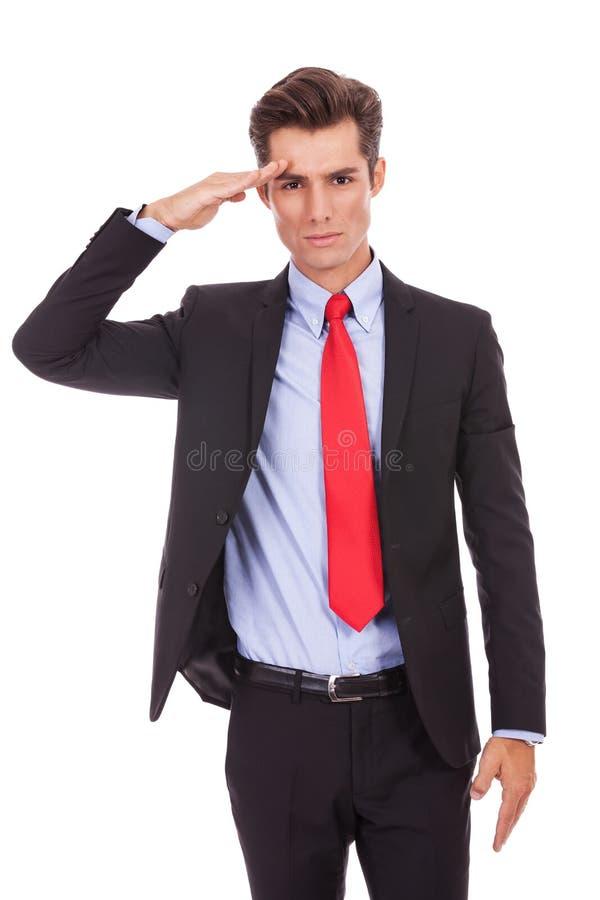 De bedrijfs mens geeft militaire begroeting royalty-vrije stock afbeelding