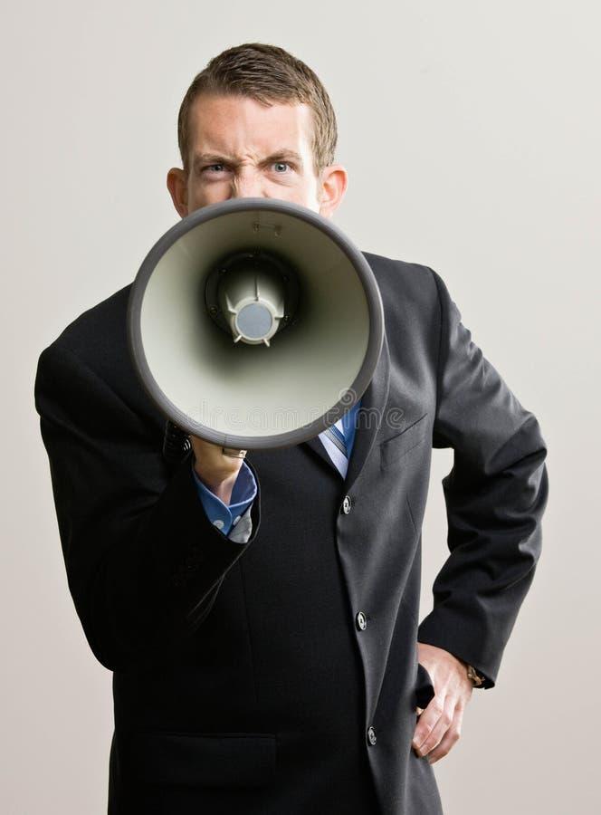 De bedrijfs mens schreeuwt in megafoon royalty-vrije stock afbeeldingen