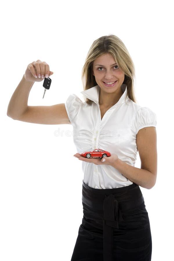 De bedrijfs vrouw adverteert het verkopen van de auto's stock afbeeldingen