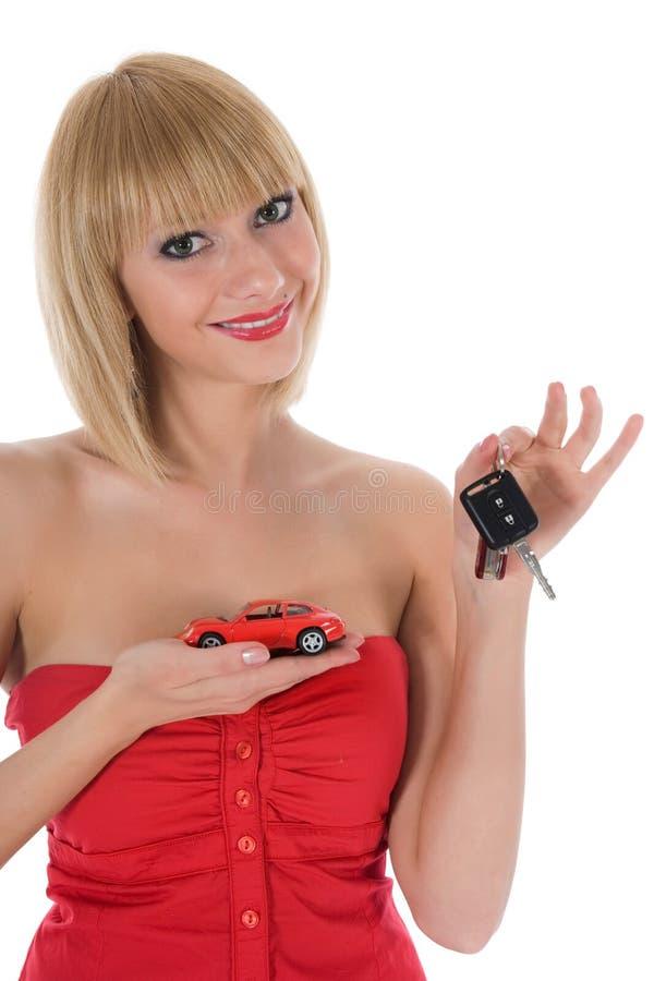 De bedrijfs vrouw adverteert het verkopen van de auto's stock foto