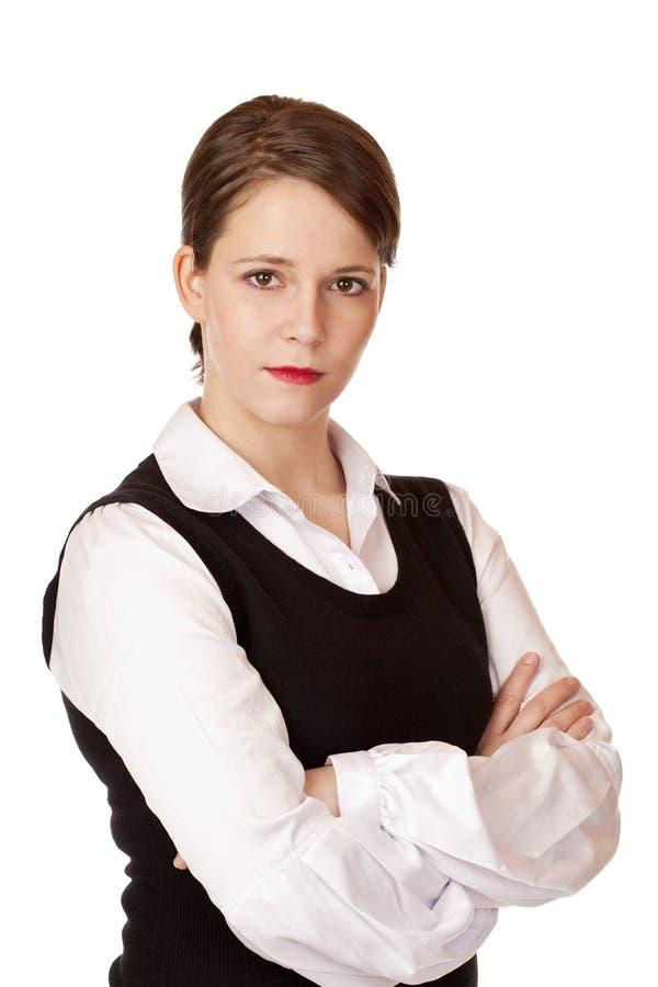 De bedrijfs vrouw met gekruiste wapens kijkt ernstig royalty vrije stock afbeeldingen - Secretaresse witte ...