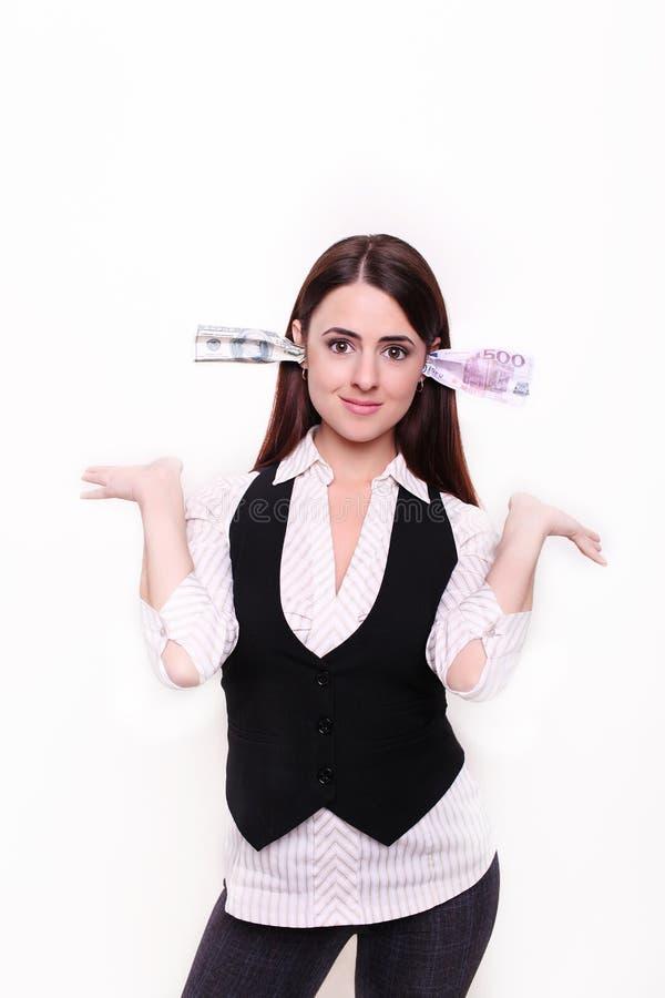 De bedrijfsdame houdt het geld in de oren stock foto
