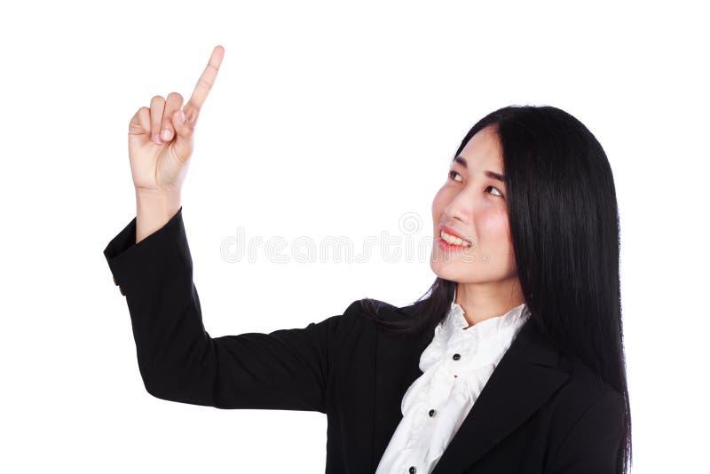 De bedrijfsdievrouw toont wijsvinger omhoog op een witte backgroun wordt geïsoleerd royalty-vrije stock afbeeldingen