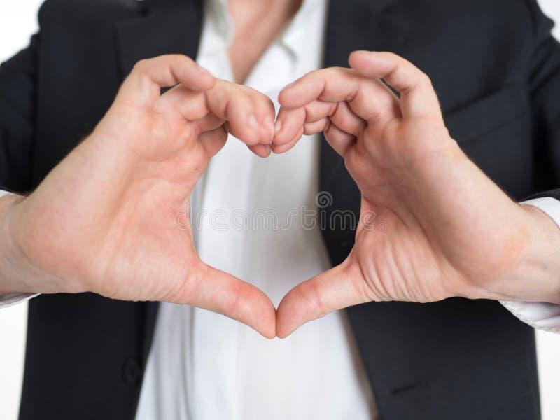 De bedrijfsmens maakt hartvorm met zijn hand royalty-vrije stock afbeelding