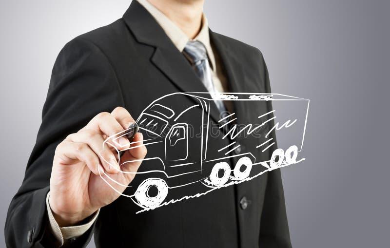 De bedrijfsmens trekt vrachtwagenvervoer royalty-vrije stock afbeeldingen