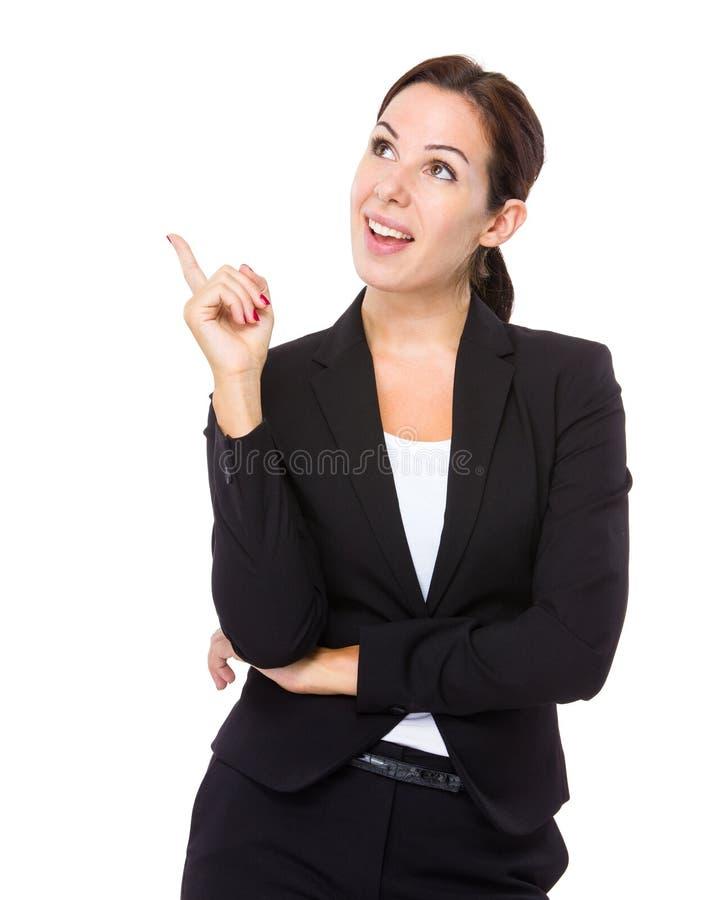 De bedrijfsvrouw denkt aan idee stock fotografie