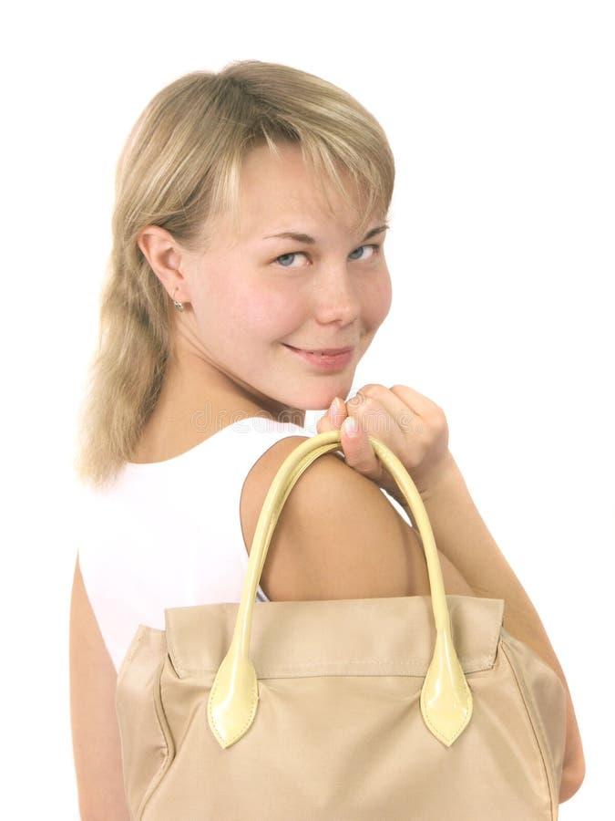 De bedrijfsvrouw met een zak stock fotografie