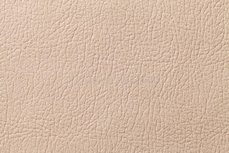 De beige achtergrond van de leertextuur met patroon, close-up stock foto's