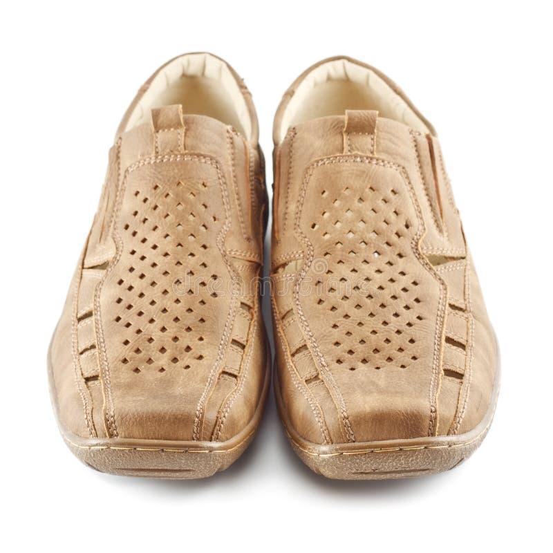De beige Schoenen van het Suède stock afbeeldingen