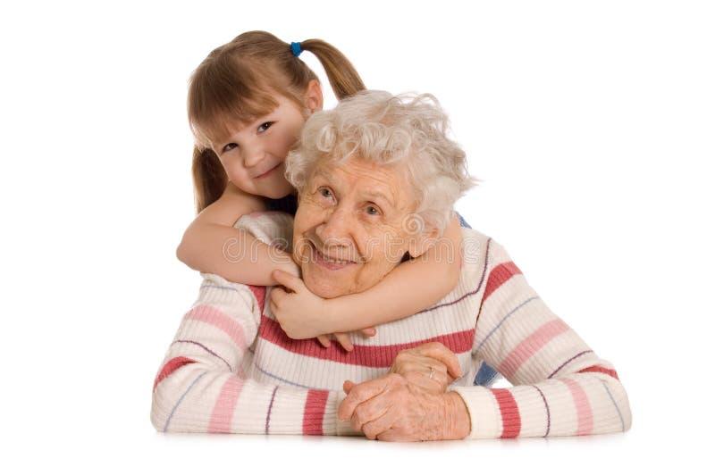 De bejaarde met de kleindochter royalty-vrije stock afbeeldingen