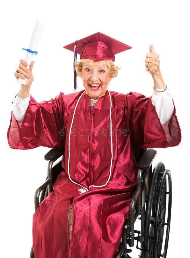 De bejaarden behalen in Rolstoel een diploma stock fotografie