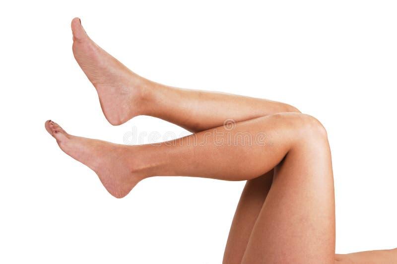 De benen van een jonge vrouw. stock afbeeldingen