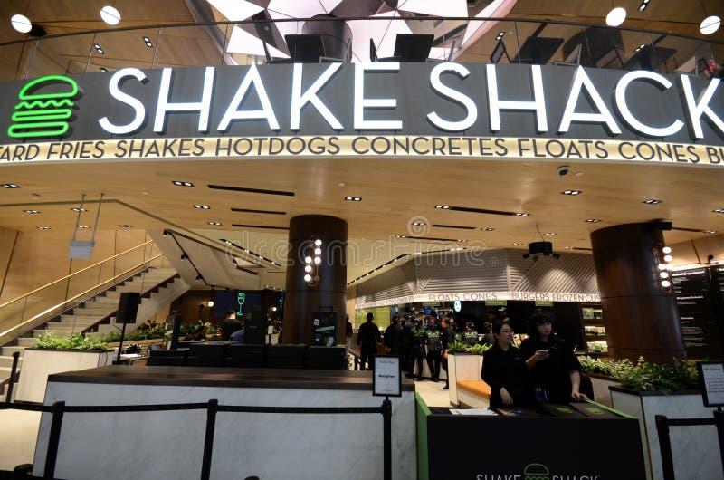 De beroemde van de de hamburgerketting van New York de Schokkeet heeft zijn eerste afzet in Singapore bij Juweelchangi Luchthaven royalty-vrije stock fotografie