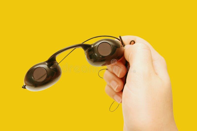De beschermende brillen van de bruine kleur stock afbeeldingen